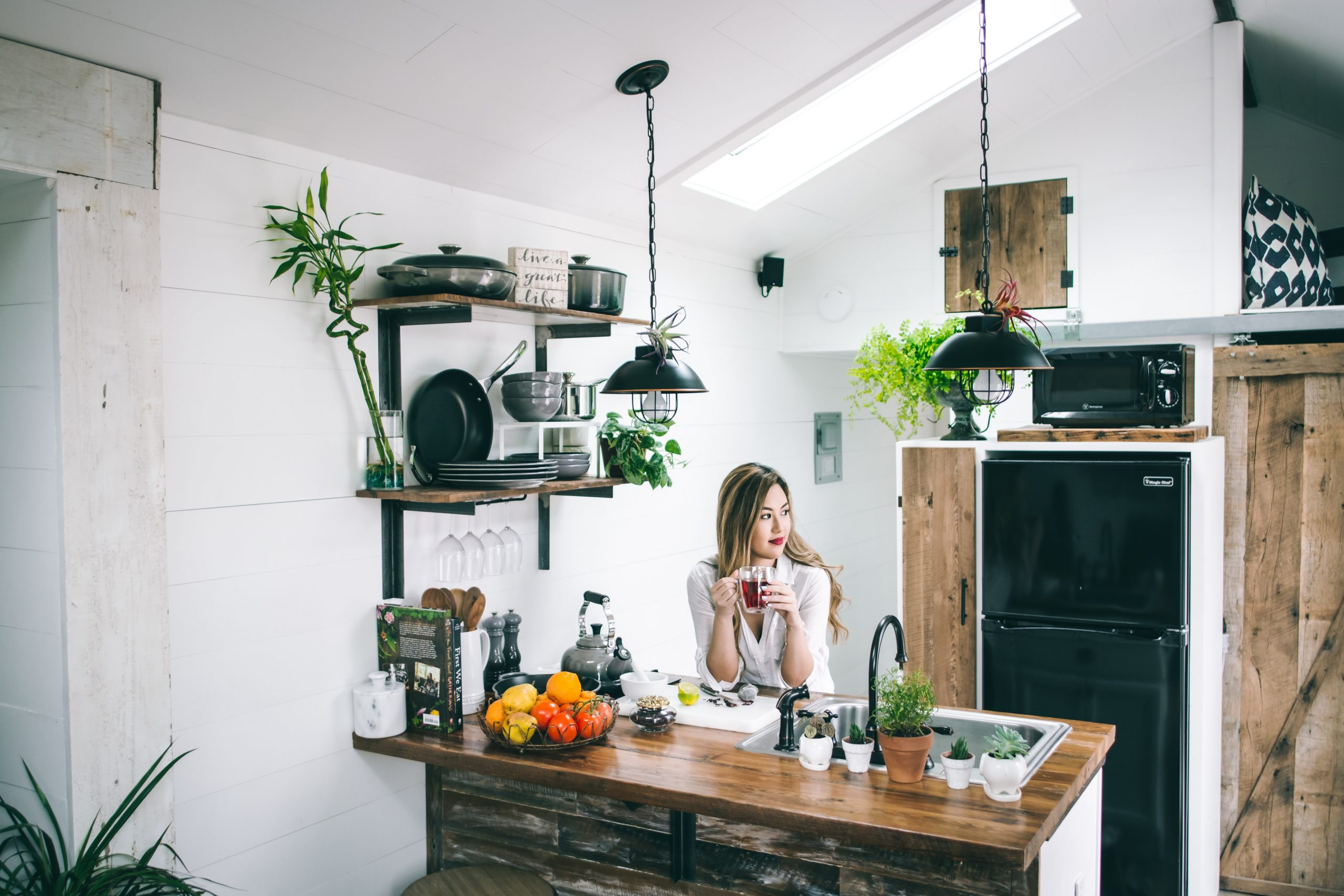Woman sitting kitchen lights plants wooden