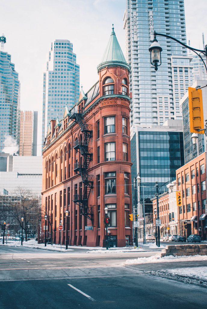red brick building city high rise skyscraper snow road canada