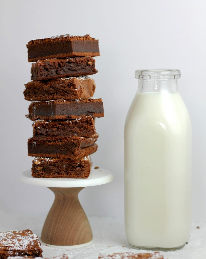 Milk bottle glass brownie chocolate white wooden stand