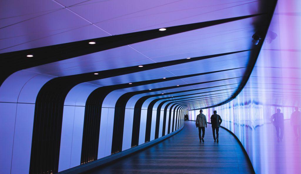 Tunnel future architect lights blue purple people walking